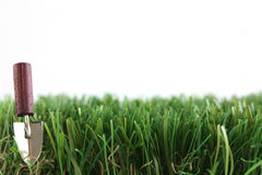 Grass edge with trowel. And copy space stock photo