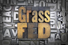 Grass Fed. Written in vintage letterpress type royalty free stock images