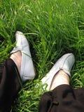 Grass feet. Feet rest on grass Royalty Free Stock Photo