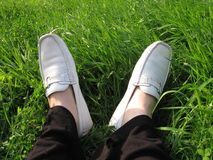 Grass feet. Feet rest on grass Royalty Free Stock Image