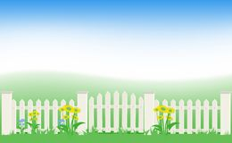Grass and fence under blue sky. Stock Image
