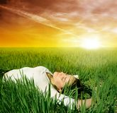 Grass field. A woman on the grass field Royalty Free Stock Photo