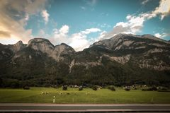 Grass Field With Background of Mountains royalty free stock photos