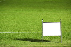 Grass field with blank notice board Royalty Free Stock Photo
