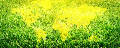 Grass field close up. Football field. World map background. Panoramic image stock images