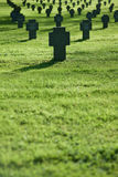 Grass field with crosses during  sunset, cemetery Stock Image