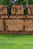 Grass field in front of ancient city wall. Grass field in front of ancient city brick wall Stock Image