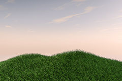 Grass Field Hills and Open Sky Stock Image