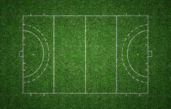 Grass Field Hockey Pitch. Green grass pitch of field hockey with white lines marking the pitch Stock Image