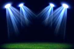 Grass field lit with bright spotlights Royalty Free Stock Photos