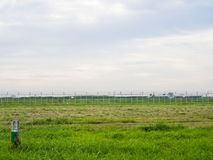 Grass field and metal fence. Country and border background Royalty Free Stock Images