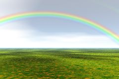 Grass field with rainbow Royalty Free Stock Image