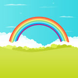 Grass field with rainbow. On background Royalty Free Stock Photo