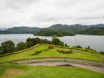 Grass field at Ratchaprapha Dam Surat Thani province,Thailand Stock Photo