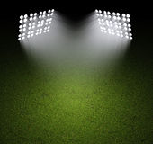 Grass field with spotlights. Grass field lit with bright spotlights Royalty Free Stock Image