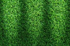 Grass field texture for golf course, soccer field or sports background concept design. Artificial grass royalty free stock image