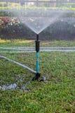 Grass field water sprayer. Water sprayer to grass field Royalty Free Stock Photography