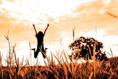 Free Grass Field With Blurred Background Of Jumping Person And Stand Alone Tree In Nature  With Sunset Tone Stock Images - 147668594