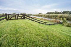 Grass field with wooden fence royalty free stock photos