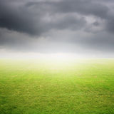 Grass fields and Beautiful rainclouds Royalty Free Stock Images