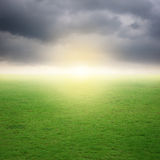 Grass fields and raincloud on bad day Royalty Free Stock Photography