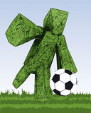 Grass figure kicking football ball on the field. One grass figure is kicking football ball on the field in match Stock Photography