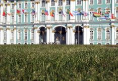 Grass, flags and palace Royalty Free Stock Photography