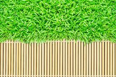 Grass frame on bamboo texture background Stock Photo