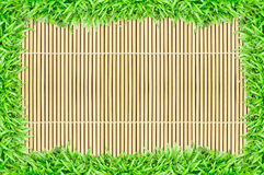 Grass frame on bamboo texture background Stock Photos