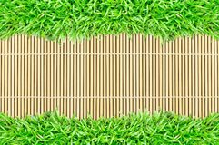 Grass frame on bamboo texture background Royalty Free Stock Photo