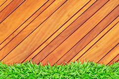 Grass frame on wood Royalty Free Stock Photography
