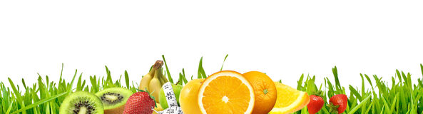 Grass & Fruits. Grass with fruits and white background Royalty Free Stock Photo