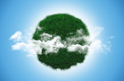 Grass globe with clouds Stock Photo