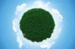 Grass globe with clouds Royalty Free Stock Image