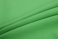 Grass green cloth made by cotton fiber. Cotton, the most widely used natural fiber in clothing today, is soft、warm and breathable Royalty Free Stock Photography