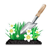 Grass with ground and garden trowel Royalty Free Stock Image