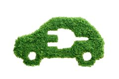 Green grass eco electric car isolated. Grass growing in the shape of a car with a cut out plug. Invest in alternative fuel solutions concept Stock Photo