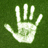 Grass hand print. Green grass growing  hand print Royalty Free Stock Images