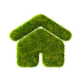 Grass home icon from grass on blue sky background Royalty Free Stock Image