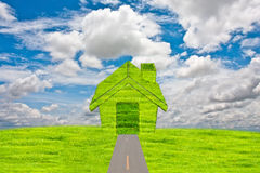 Grass home icon from grass with sky backgroud. Royalty Free Stock Image