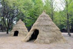 Grass house for homeless person Stock Photos