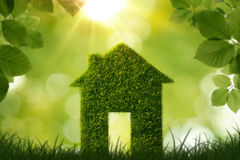 Grass house symbol stock photos