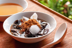 Grass jelly dessert, herbal gelatin, Chinese style. Stock Images