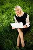 On the grass with laptop Royalty Free Stock Photos