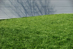 Grass Lawn and Aluminum Wall Stock Photos