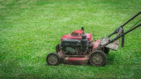Grass Lawn Mower Mechanical Device royalty free stock photos