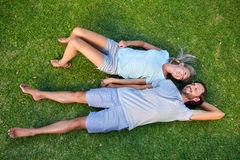 Grass laying couple Stock Image