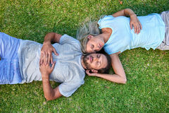 Grass laying sleeping couple Stock Photos