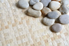 Grass mat with pebbles. A pieces of grass mat with pebbles on it Stock Photos