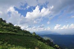Grass, mountain and cloudy sky view of Chiangmai Thailand Stock Photos